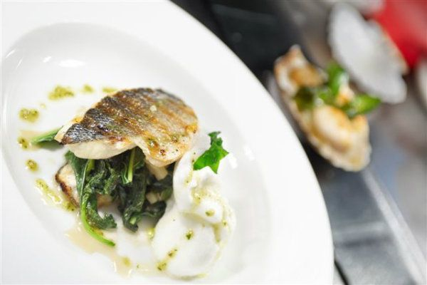 Grilled bass fish fillet with green amaranth