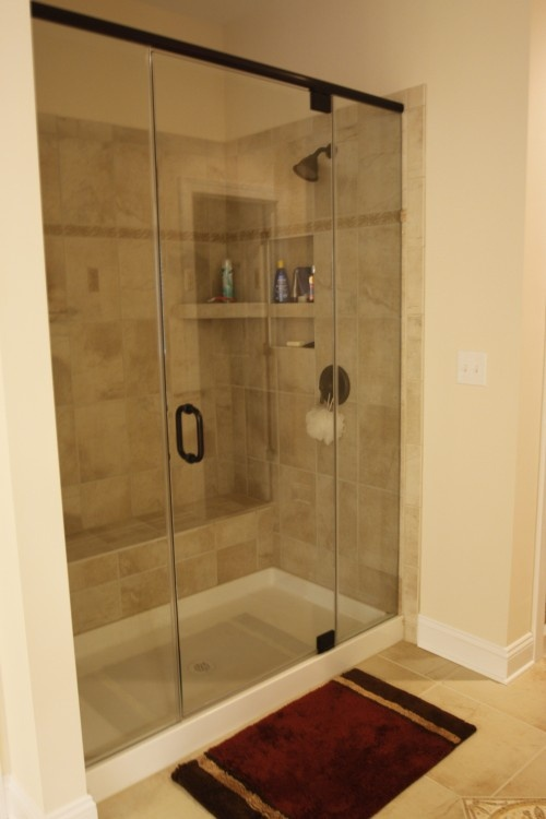 White Shower Base With Tiles Doesn T Look Too Bad Maybe Even Help Tie In The Tub And Sinks Bathroom Remodel Bath