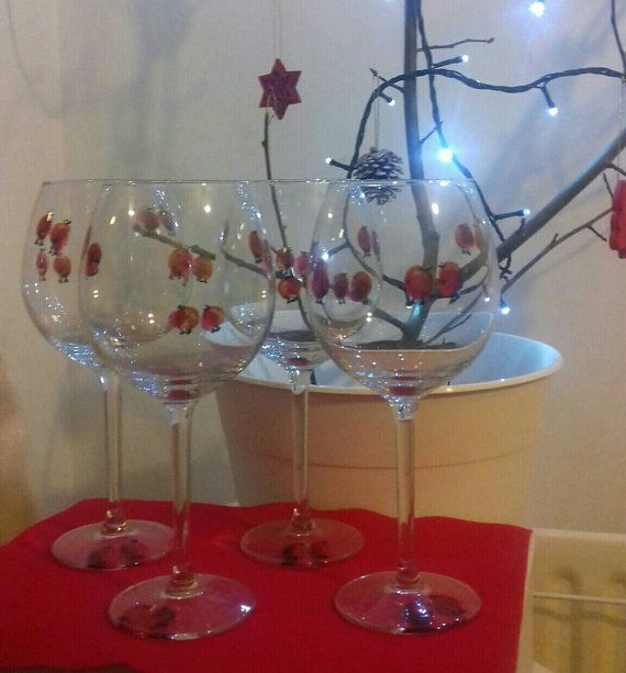 Check out this item in my Etsy shop https://www.etsy.com/uk/listing/499299171/hand-painted-robin-wine-glasses