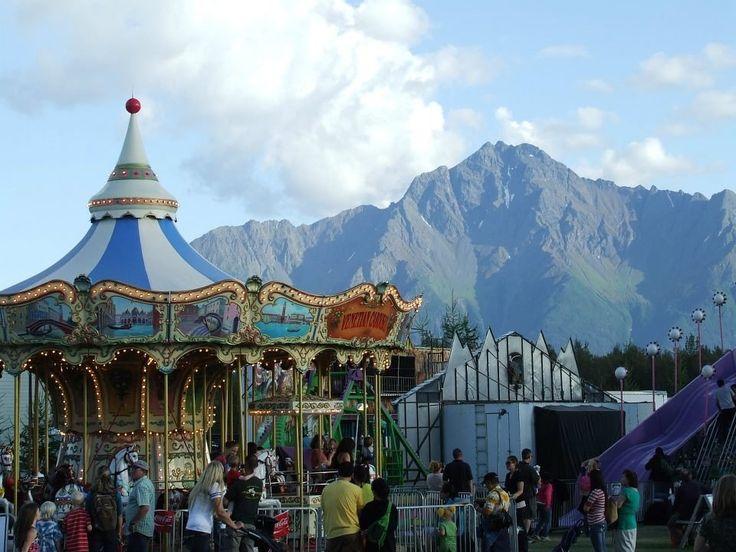 Alaska State Fair - Palmer, AK, United States. Carosel with beautiful Alaskan Mountains in the background