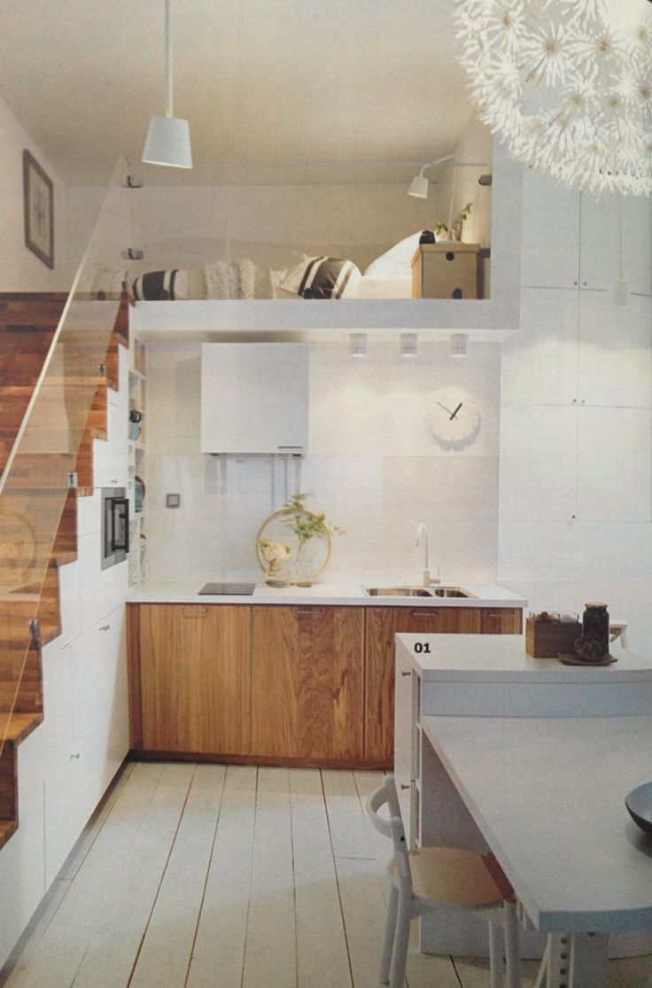 The glass rail visually opens up the space. And kitchen storage built into the stairs - amazing..