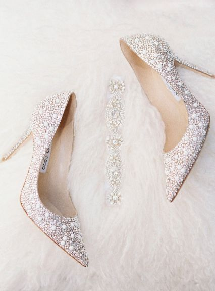 """You can never go wrong getting these types of """"wedding details"""" shots. Shoes + garter = perfection, even if you aren't wearing fancy Jimmy Choos"""