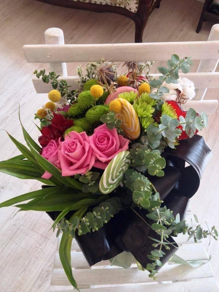 Flowers, candies, lolly pops bouquet by Atelier Floristic Aleksandra