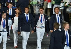 France's tennis players Jo-Wilfried Tsonga (C,L) and Richard Gasquet (C,R) walk with their delegation on July 27, 2012 at the Olympic stadium in London, during the opening ceremony of the London 2012 Olympic Games.