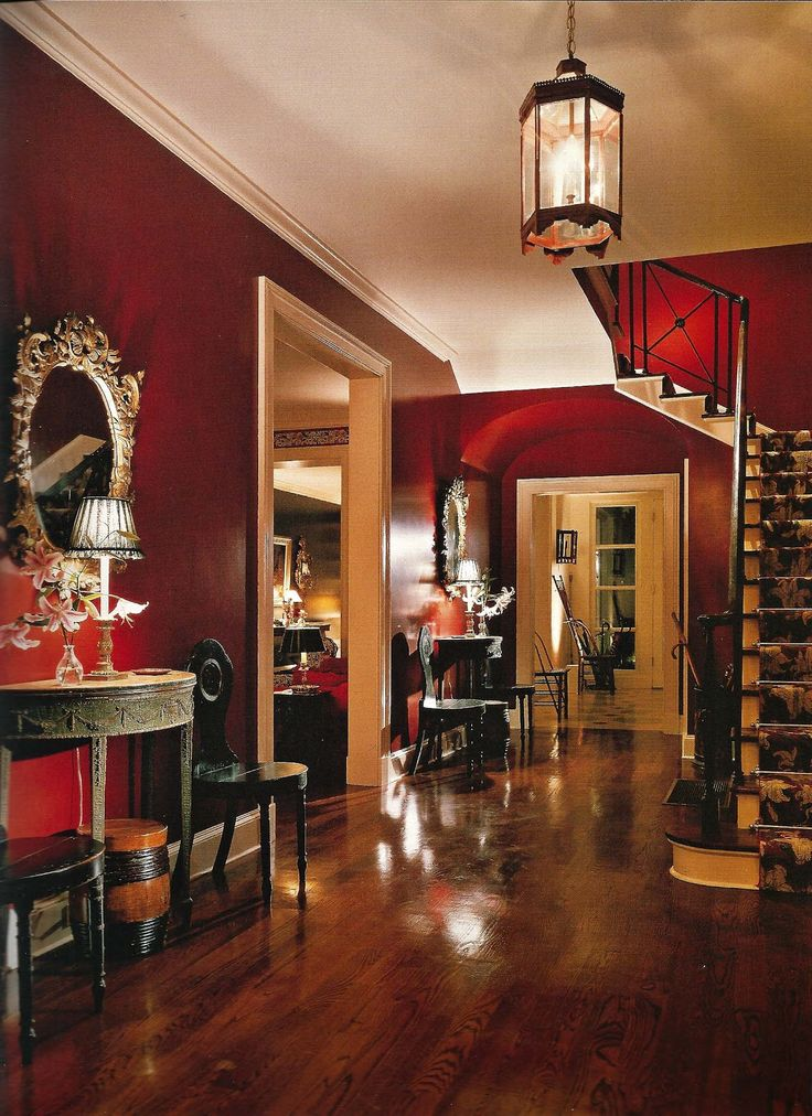 Love the rich colors and contrast in this space.  Deep reds, blacks, browns  all molded together.  The contrast between the red of the foyer and the creme in that back room is really nice, too.