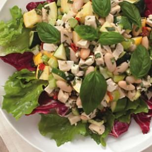 Chicken & White Bean Salad, using raw zucchini and celery, ricotta salata or feta, sun-dried tomatoes, and fresh basil, dressed with a vinaigrette.