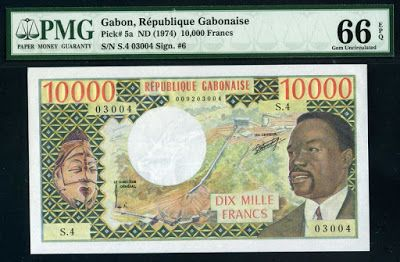 Currency  of Gabon 10000 francs President Omar Bongo banknote of 1974, issued by the Bank of Central African States - Banque des États de l'Afrique Centrale  (Central African CFA franc). Gabon banknotes, Gabon paper money, Gabon bank notes, Gabonese currency.  Obverse: Portrait of President Omar Bongo, was a Gabonese politician who was President of Gabon for 41 years from 1967 until his death in office in 2009.