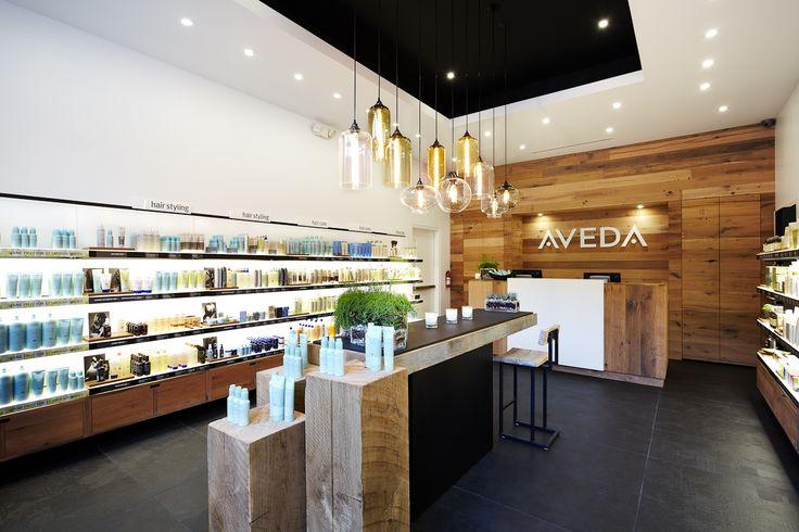 Niche Modern Bare Bulb Pendant Lighting in An Aveda Beauty Store