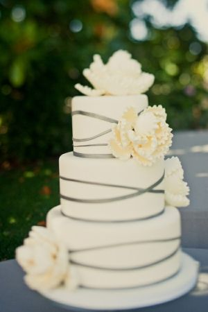 pretty & simple wedding cake diff colors white black ribbon purple flowers!