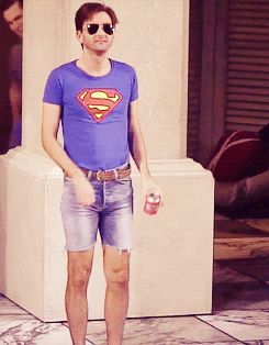 David Tennant gif, I have no clue what he is doing....hula maybe? who cares? he's wearing cut off shorts and a tight shirt!