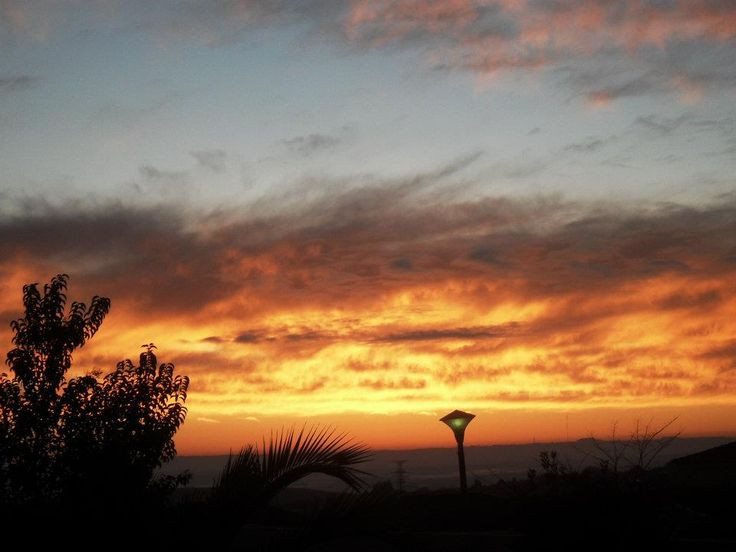 The South African Sunrise. I took this photo a few years ago in the Mpumalanga province (translates to: the place where the sun appears). Scenes like this remind me how amazing South Africa is