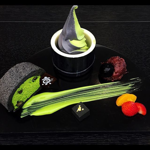 """Zen Roll Kaiseki"" by Chef Dej Kewkacha.  Bamboo charcoal roll cake stuffed with premium grade UJI Matcha cream served in royal banquet 'Kaiseki' style with 'Matcha-Sumi' soft cream and condiments including charcoal-black 'Nama' chocolate truffle 'shiratama' mochi 'azuki' red beans matcha sauce and fruit selection."