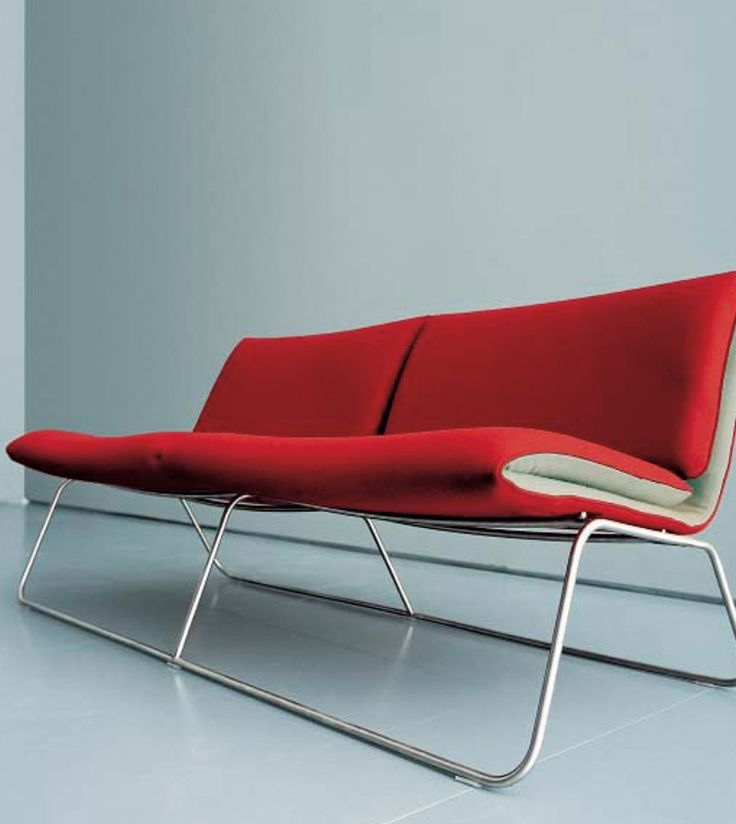 A burst of colour in office lounge chair design. A pop of red to your office design creates an engaging space. #workspace #office #furniture