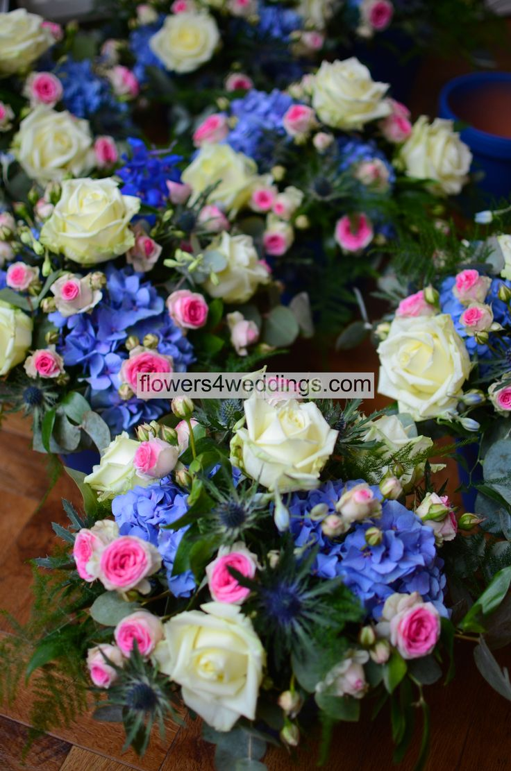 Ivory, blue and pink table arrangements