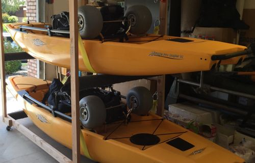 """a couple of pictures of a rolling rack - built for PA 14s. Other than size to accommodate the PA 14s (outside dimensions of the rack are 78"""" x 47""""), more or less duplicated the design from a post by a JKay on the Snaggedline Kayak Fishing forum website"""