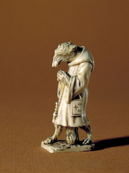 Museum of artifacts Fox in a monk costume. Ivory figure, 6 cm tall. Dated to the time of the Reformantion in Denmark. 1530