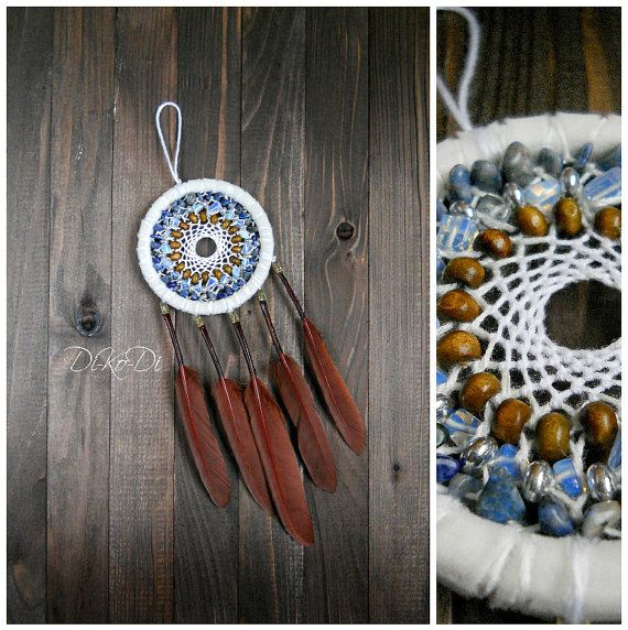 "Diameter 11 cm (4.3 inch), length 23 cm (9 inch)    Materials: sodalite, glass, moonstone, strands of cotton, feathers, wood beads    Dreamcatcher, dream catcher (angl. inanimate form word ""spider"", or ""trap dreams"") — Indian talisman that protects the sleeper from evil spirits. Bad dreams become entangled in a cobweb, and good slip through the hole in the middle.    You can hang the dream catcher in the nursery, bedroom, living room and even on the veranda.    Let me know if you want the…"