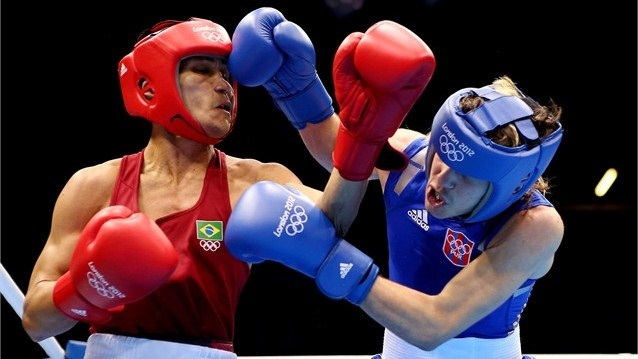 Jeyvier Cintron Ocasio of Puerto battles against Juliao Henriques Neto of Brazil in the men's Fly Boxing