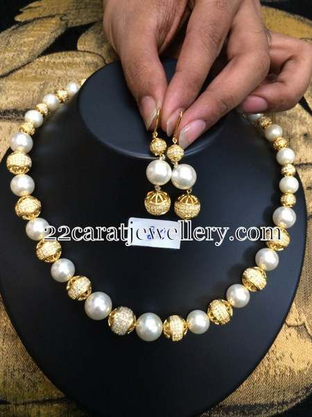 1 gram gold or gold plated metal CZ stones studded round balls and south sea pearls combination short necklace with hoops.  Cost is 4000 ...