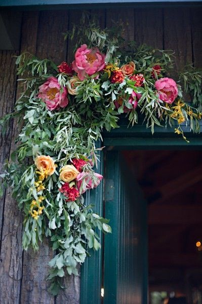 wild, dripping foliage, peonies and roses to welcome guests