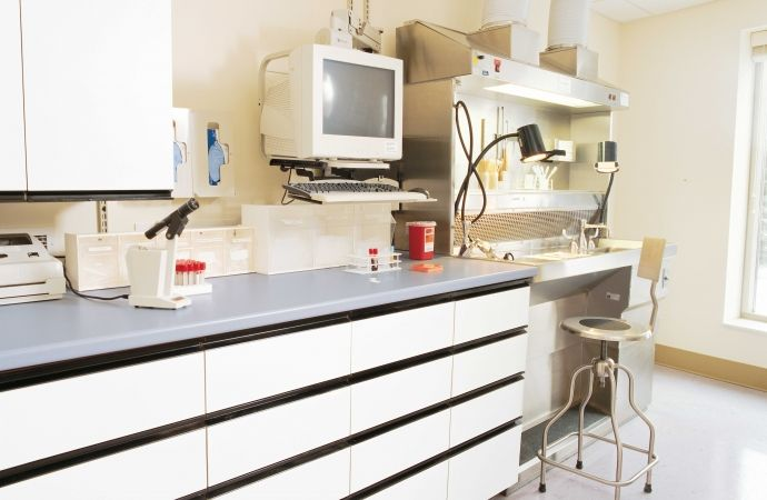 Lab tables featuring Laminex Chemical Resistant Oyster Grey.