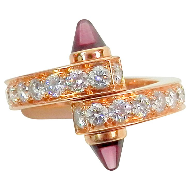 Cartier Garnet Diamond Gold Bypass Ring | See more rare vintage More Rings at http://www.1stdibs.com/jewelry/rings/more-rings