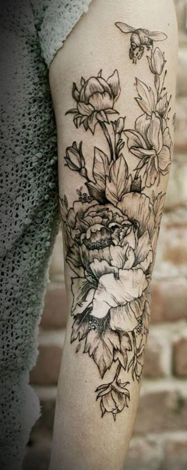 grey flowers & bee tattoo
