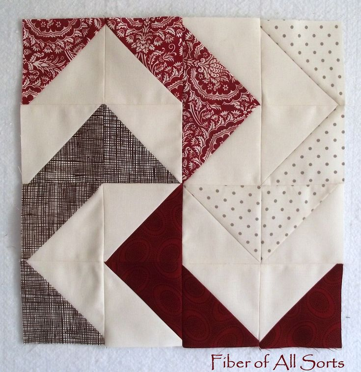 Quilt block, as yet unnamed. When I have time to kill I'll have to dig through the blog at the attached link to find out what it's called,