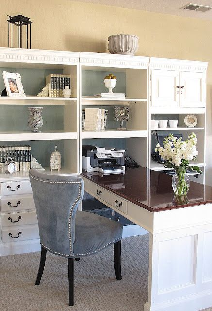My idea of the perfect home office...  It was made from dark wood bookcases painted white and a chair from Marshalls