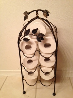 Wine rack toilet paper holder. IDK why I didn't pull this thing out of storage sooner to use for this!!!