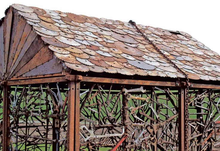 Detail of the tool shed's roof, showing saw blade shingles and siding.