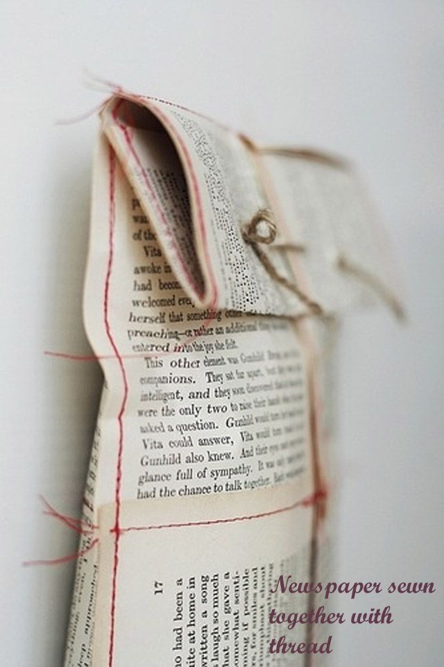 Newspaper sewn together with thread.  Gift wrapping idea.