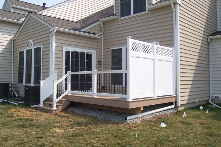 Whether you need a full, two-story deck with a pergola or a simple, smaller deck with a privacy fence like this one, let the professionals at Decks R Us help. We work with all types of homes and properties, so we know what will work for your needs and your budget. Ready to get started? Contact us today, and we'll be more than happy to give you a free estimate! #deckconstruction #deckideas #smalldeckdesigns