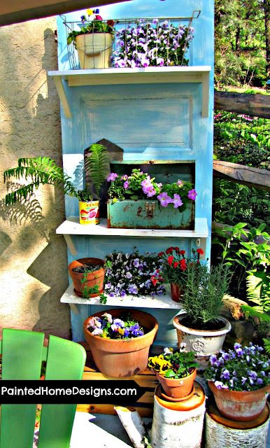 repurposed plant holder: old door with shelves