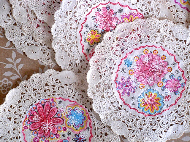 Doily garland. If you would like to see the tutorial, it's right here: dkmart.typepad.com/dkm-art/2011/05/fun-with-doilies-and-c...