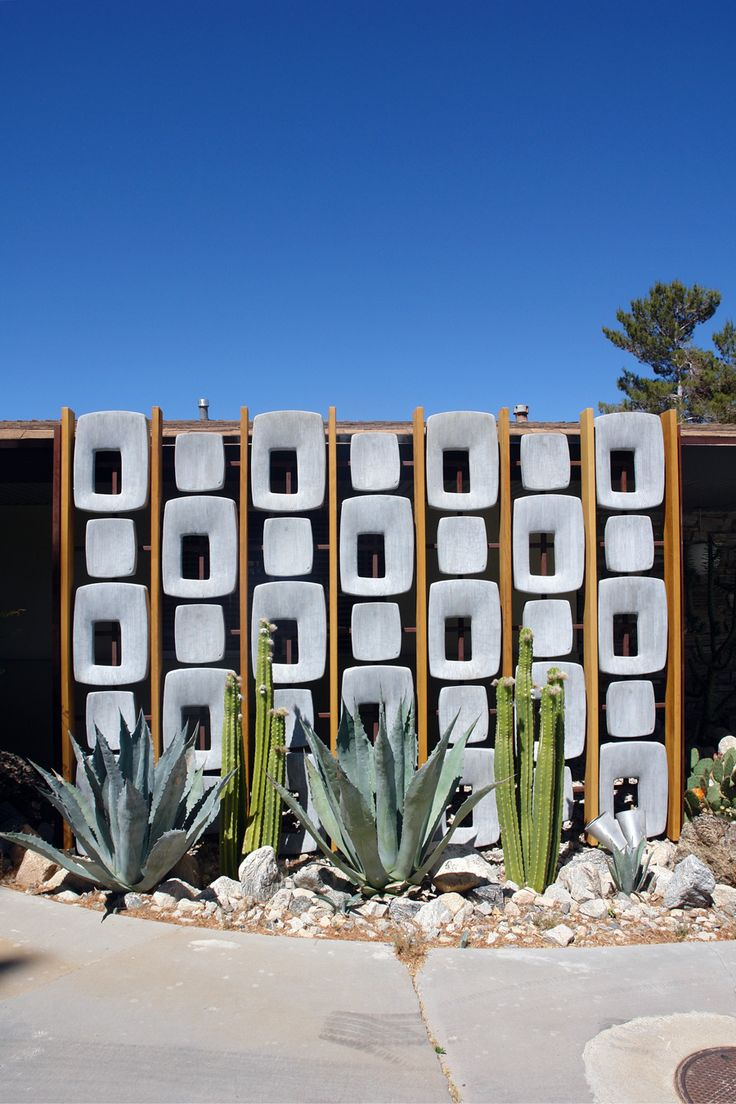 Succulents and cactus with a bit of outdoor sculpture to create a mid-twentieth century vibe.