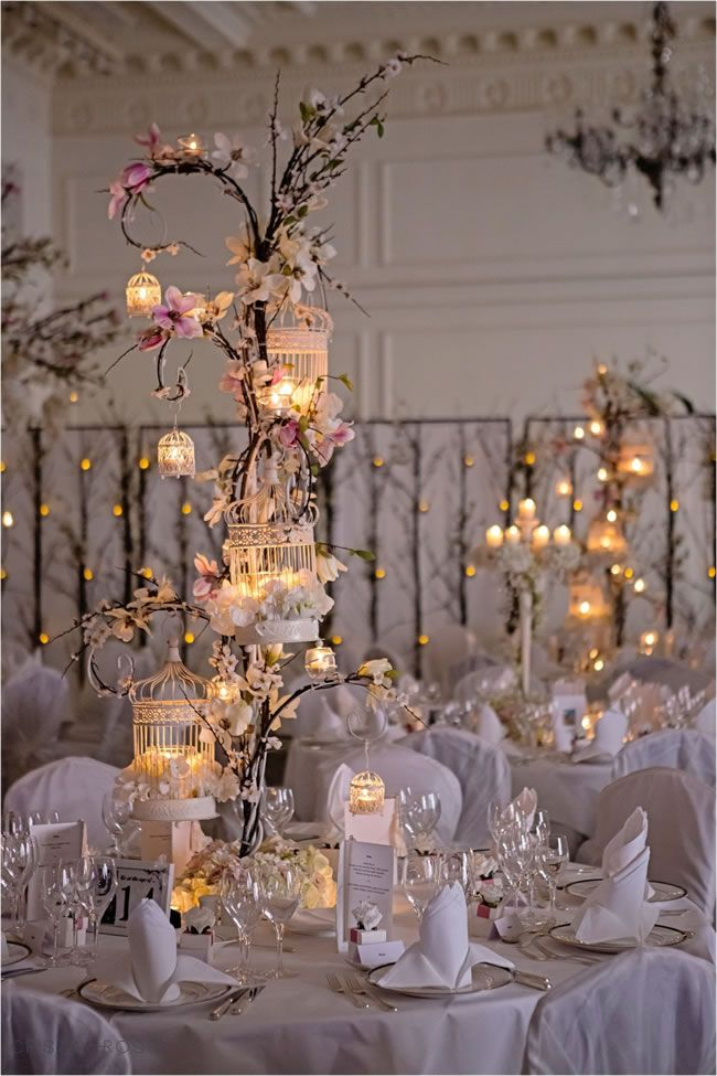 Candles make these blossom tree centrepieces from Essential Couture extra romantic - perfect for making winter weddings cosy! #weddingideas