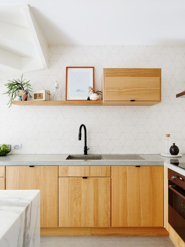 organic modern; concrete countertops, wood cabinets, white tile backsplash