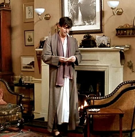 Even in his night clothes, Holmes was not without his scarf. Love that hair. :)