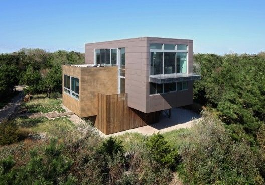 """Residential Architecture: Beach Walk House by SPG Architects: """"..This Fire Island house is located directly behind beach-front dunes. The strict requirements of both FEMA and local codes regarding height, lot line, setbacks, and site coverage; the proximity of neighbors; and very specific view corridors all presented a host of challenges..Our response was to create a dynamic composition of three intersecting rectilinear forms, which is rotated on the site off the prevailing grid. This…"""
