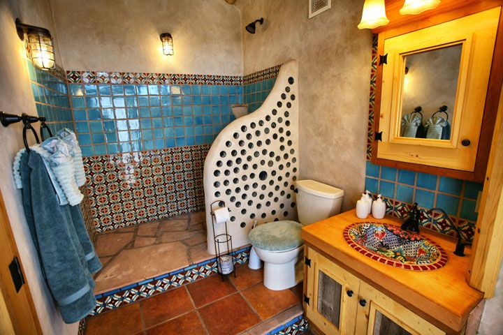 Earthship house bathroom... LOVE this... mostly the bottle shower screen