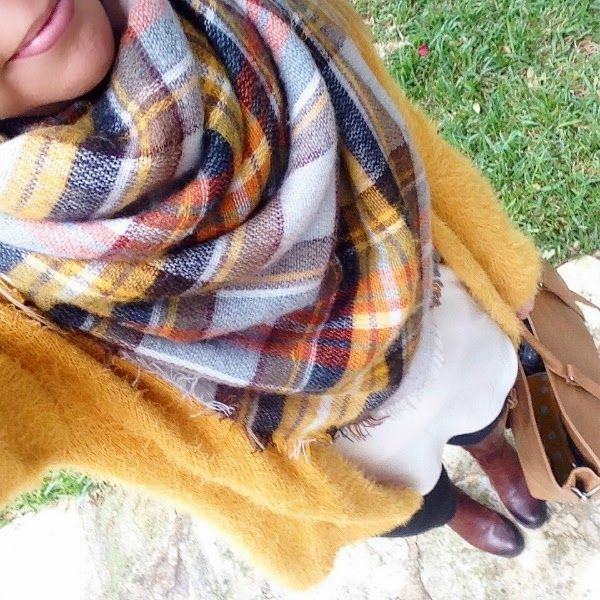 Plaid blanket scarf outfit idea. Pick up a color in the scarf and wear that color cardigan sweater (or pullover sweater). With jeans and riding boots