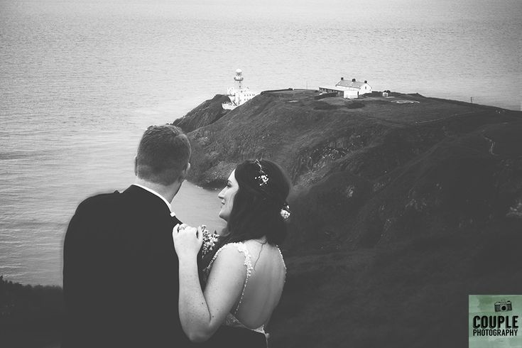 The bride & groom take in the amazing view on Hoiwth summit. Wedding in The Abbey Tavern, Howth. Photographed by Couple Photography.