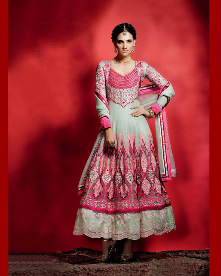 Layered,soft net Anarkali suit in grey and bright pink with cut work border.Rich embroidery work all over.