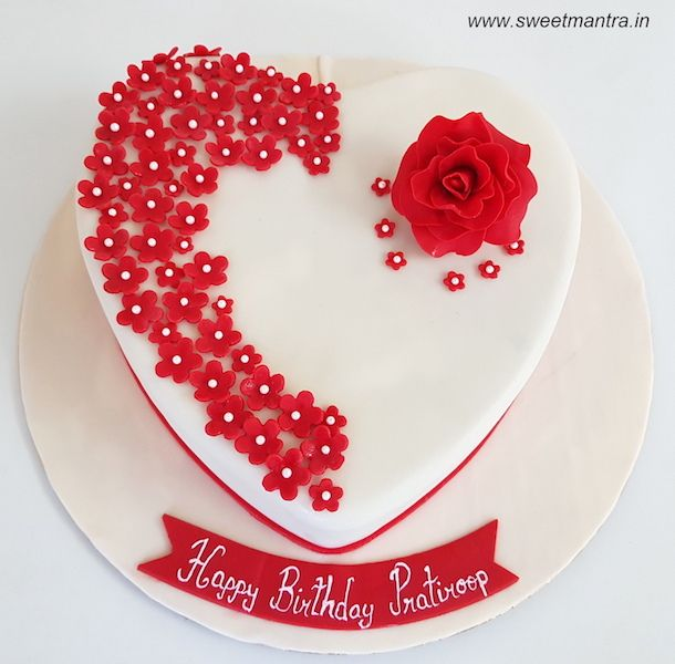 Heart Shaped White Designer Fondant Cake With Red Flowers And Rose For Fiance S Birthday At Pune Happy Anniversary Cakes Heart Shaped Cakes Anniversary Cake