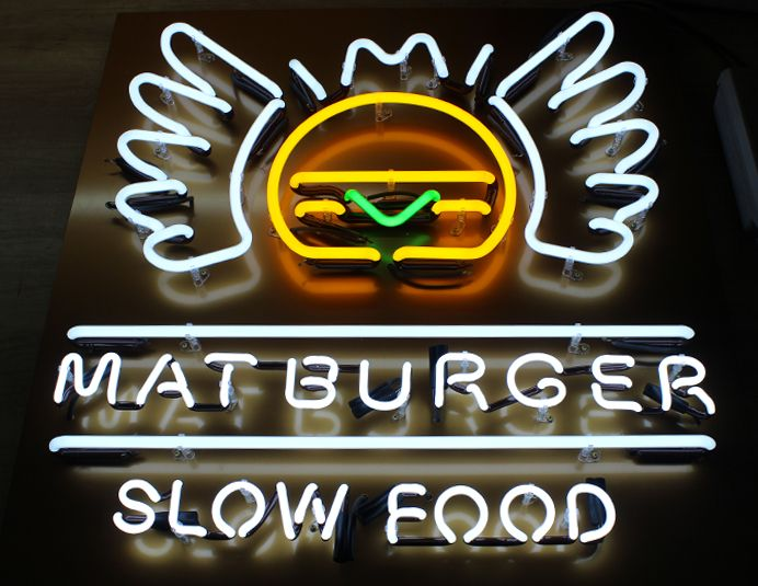 Custom neon sign for burger restaurant. We specialize in all kinds of light signs. We can create the perfect sign for your needs. Contact us at pretende.pl