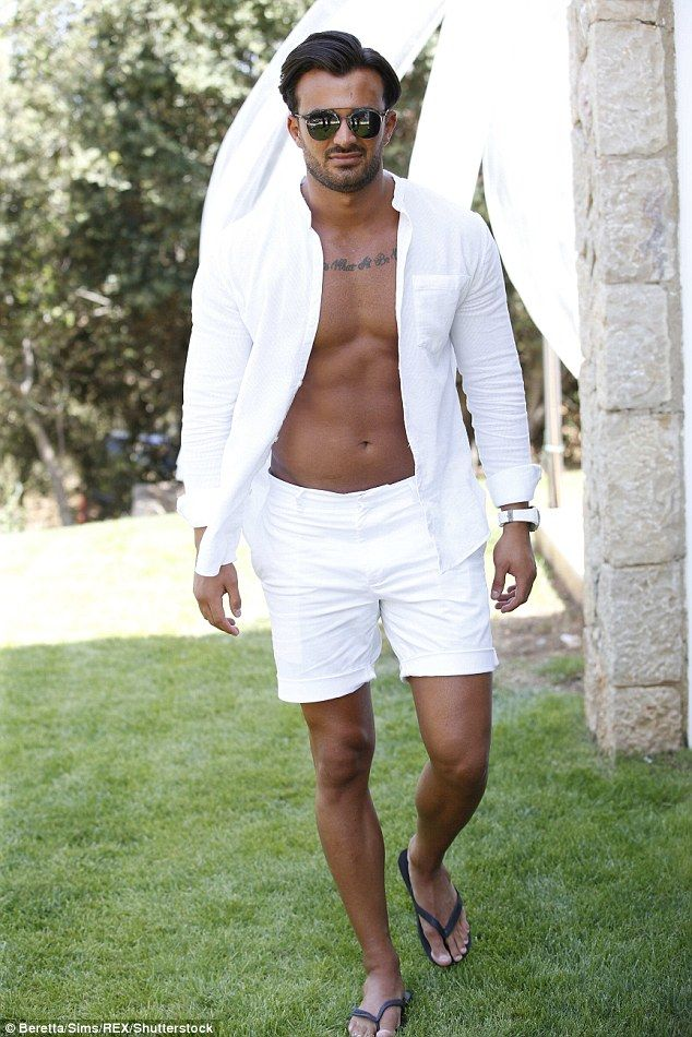 Boys can sizzle too! Michael Hassini rocked the all-white party theme in shorts and an open shirt, showing off his buff chest