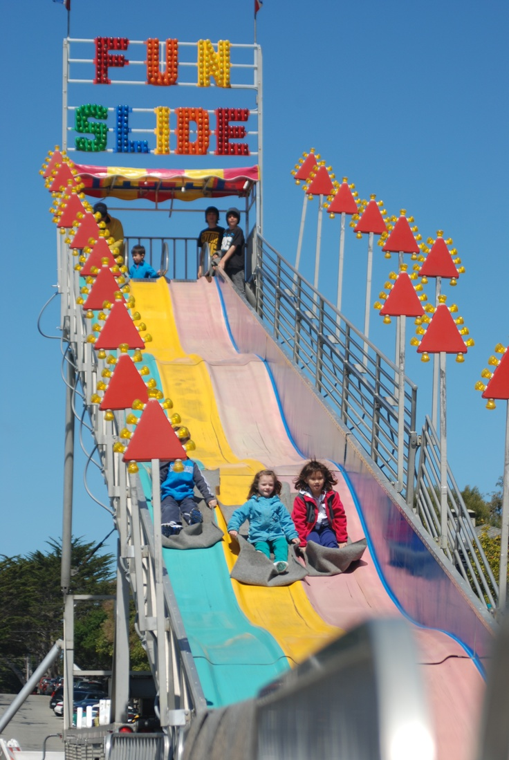 Kids riding the Fun Slide at The Good Old Days Celebration and Music Festival! The Festival includes the County's largest arts and crafts show, with over 200 art and food vendors in downtown Pacific Grove, a parade down Pine Avenue, over 75 live entertainers on five stages, and lots of family fun - kids fair, carnival rides and games, and more! www.pacificgrove.org