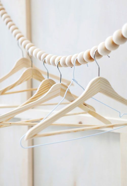 rope with beads and hangers for drying laundry or hanging clothes in the closet