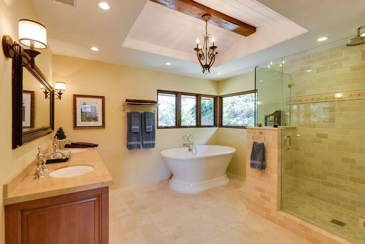 Craftsman Master Bathroom with Signature Hardware Avon Acrylic Pedestal Tub, MS International  Sunny Light Limestone